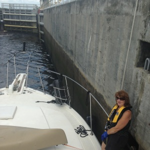 Claudia handling lines as we lock. Notice the water level change on lock wall