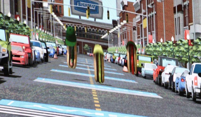 Hotdogs Ketchup, Relish, and Mustard racing to the ballpark