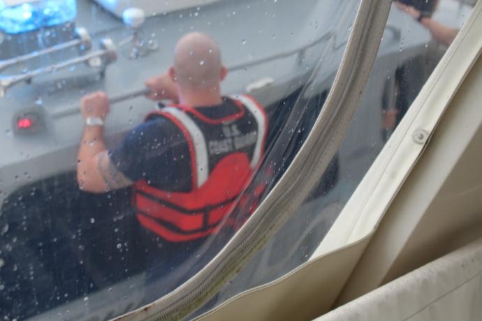 Coastie leaving the boat
